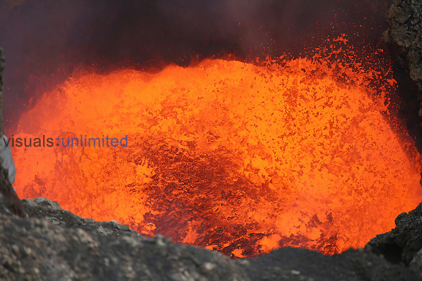 Violently active lava lake in bottom of Santiago Crater of Erupting Masaya Volcano, Nicaragua. Lava bubbles burst and eject lava bombs.