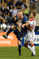 Conor Casey (6) of the Philadelphia Union is marked by Perry Kitchen (23) of D. C. United. The Philadelphia Union defeated D. C. United 2-0 during a Major League Soccer (MLS) match at PPL Park in Chester, PA, on August 10, 2013.