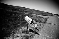 An off-kilter mailbox stands by the highway in rural eastern Montana near Jordan, Montana.