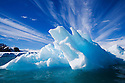 Small iceberg drifting in fiord, June; Svalbard, Norway