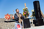 A Buddhist priest offers prayer for the 74 elementary school students and teachers who were swept away during the March 11 tsunami, at an ad hoc  shrine outside Okawa elementary school in Ishinomaki, Miyagi Prefecture, Japan on 07 Sept. 2011. Photograph: Robert Gilhooly