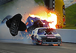 Jun. 18, 2011; Bristol, TN, USA: NHRA pro mod driver Roger Burgess crashes in flames behind Kenny Lang after winning the first round race during eliminations at the Thunder Valley Nationals at Bristol Dragway. Mandatory Credit: Mark J. Rebilas-
