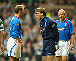 Fernando Ricksen and Stefan Klos square up to each other as Rangers lose the plot in the new year game at Celtic Park in 2004