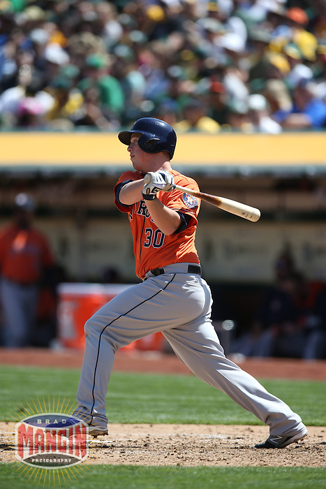 OAKLAND, CA - APRIL 19:  Matt Dominguez #30 of the Houston Astros bats against the Oakland Athletics during the game at O.co Coliseum on Saturday, April 19, 2014 in Oakland, California. Photo by Brad Mangin