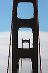 A rare afternoon brought a white backdrop of fog to the Golden Gate Bridge.