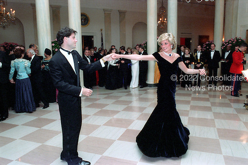 In this photo provided by the Ronald Reagan Presidential Library, Princess Diana dances with John Travolta in the Cross Hall of the White House in Washington, D.C. at a Dinner for Prince Charles and Princess Diana of the United Kingdom on November 9, 1985.<br />