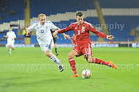 Kari Arkivuo of Finland attempts to stop Gareth Bale of Wales putting in a cross to the centre during the Wales v Finland Vauxhall International friendly football match at the Cardiff City stadium, Cardiff, Wales. Photographer - Jeff Thomas Photography. Mob 07837 386244. All use of pictures are chargeable.