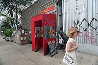 Trendy Roberta's restaurant in the Bushwick neighborhood of Brooklyn in New York on Saturday, August 16, 2014. Roberta's was one of the first restaurants to set up shop in the neighborhood causing ti to become a destination. The neighborhood is undergoing gentrification changing from a rough and tumble mix of Hispanic and industrial to a haven for hipsters and a destination for tourists, forcing many of the long-time residents out because of rising rents. (©Richard B. Levine)