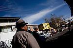 Bystanders watch police work a crime scene in Ciudad Juarez.