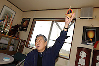 "CEO Masanori Honda holds a mock-up firework at Katakai Fireworks Co., Ltd, Katakai, Japan, April 7, 2009. The company makes the world's largest firework, a 120cm round shell called a ""yonshakudama""."