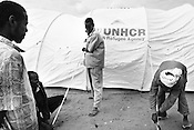 UNHCR employees and volunteers pitch an igloo tent outside the  Dagahaley refugee camp in the Dadaab refugee camp in northeastern Kenya. Hundreds of thousands of refugees are fleeing lands in Somalia due to severe drought and arriving in what has become the world's largest refugee camp. Photo: Sanjit Das/Panos