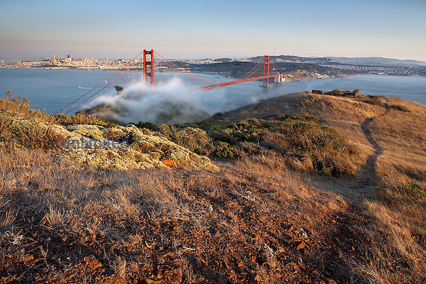 Fog partially enveloping the Golden Gate Bridge over San Francisco Bay with the city of San Francisco in the background, California, USA.