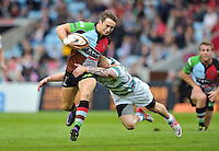 Miles Mantella is tackled by Tom Homer. J.P. Morgan Premiership Rugby 7s match, between London Irish and Harlequins on July 13, 2012 at the Twickenham Stoop in London, England. Photo by: Patrick Khachfe / Onside Images