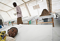 Children inside the Medecins Sans Frontieres (MSF) tent in the Kibati camp for displaced people recieve re-hydration fluids. The more serious cases are placed on a drip. MSF started a cholera treatment centre after cholera was diagnosed in the local health centre. Due to the new influx of displaced people after violence, Kibati camp is now overcrowded and the water and sanitation situation is deteriorating. An outbreak of cholera could be a further threat to many lives.