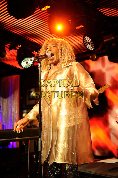 Martha High (Martha Harvin).Martha High and Speedometer performing in concert, Under The Bridge, London, England, UK,.19th April 2013..music concert gig live on stage half length gold jacket shirt microphone singing .CAP/MAR.© Martin Harris/Capital Pictures.