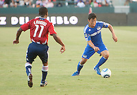 CARSON, CA – SEPTEMBER 19: Chivas USA midfielder Michael Lahoud and KC Wizard defender Roger Espinoza during a soccer match at Home Depot Center, September 19, 2010 in Carson California. Final score Chivas USA 0, Kansas City Wizards 2.