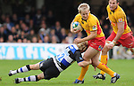 Ashley Smith is tackled by Shaun Berne. Bath V Newport Gwent Dragons, Heineken Cup Pool 5 © Ian Cook IJC Photography iancook@ijcphotography.co.uk www.ijcphotography.co.uk