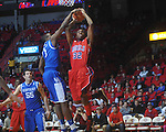 Ole Miss guard Zach Graham (32)  has his shot blocked by Kentucky's Darius Miller (1) at the C.M. &quot;Tad&quot; Smith Coliseum in Oxford, Miss. on Tuesday, February 1, 2011. Ole Miss won 71-69.