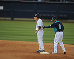 Ole Miss' Auston Bousfield (9) hits a double vs. North Carolina-Wilmington at Oxford-University Stadium in Oxford, Miss. on Saturday, February 25, 2012. Ole Miss won 6-4.