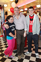 "NO REPRO FEE. 26/5/2011. NEW EDDIE ROCKET'S SHAKE SHOP. Colm Hayes with Holly and Alex are pictured in the new Eddie Rocket's Shake Shop. The design seeks to recall the vintage milkshake bars from 1950's America and re-imagine them for the 21st century. The new look aims to appeal to both young and old with a quirky and bold colour scheme and a concept of make-your-own milkshakes, based on the tag line ""You make it...We shake it!"". Eddie Rocket's City Diner in the Stillorgan Shopping Centre in south Dublin has re-opened after an exciting re-vamp and the addition of a Shake Shop. Ten new jobs have been created with the Diner's re-launch bringing the total working in Eddie Rocket's Stillorgan to 30. Picture James Horan/Collins Photos"