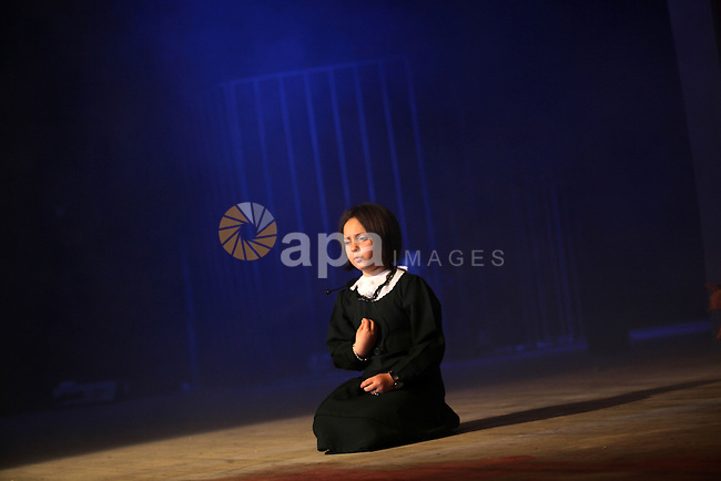"""A Palestinian girl performs in the play """"Freedom sings"""" in Gaza city on April 15, 2013. The play organised by Waed society, talks about the the life of Palestinian prisoners in Israeli jails and the Palestinian resistance, ahead of Palestinian prisoners day on April 17. Photo by Ashraf Amra"""