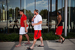 "FRESNO, CA - AUGUST 11, 2014: Fresno State football players walk through the campus ""athlete village"" after morning practice. CREDIT: Max Whittaker for The New York Times"