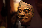 "The terracotta head of a foot soldier, protected in a dimly lit case, part of the  ""Terra Cotta Warriors: The Emperor's Painted Army,"" Exhibit directly from Xi'an in the Shaanxi Province, China debuted in 2014 at the Children's Museum, Indianapolis, Indiana, USA"