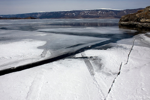 A car trek ends in a puddle of open water in otherwise frozen Lake Baikal in Siberia, Russia. The fate of the car and passenger is unknown. .They are a group of five people: Justin Jin (Chinese-British), Heleen van Geest (Dutch), Nastya and Misha Martynov (Russian) and their Russian guide Arkady. .They pulled their sledges 80 km across the world's deepest lake, taking a break on Olkhon Island. They slept two nights on the ice in -15c. .Baikal, the world's largest lake by volume, contains one-fifth of the earth's fresh water and plunges to a depth of 1,637 metres..The lake is frozen from November to April, allowing people to cross by cars and lorries.