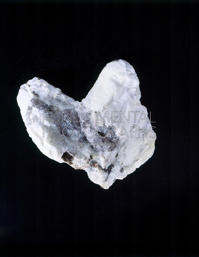 ORTHOCLASE FELDSPAR (KAlSi3O8)<br /> Constituent of Aplite Granite<br /> Specimen is feldspar in its occurrence as a constituent of Aplite (a granite of Orthoclase &amp; Quartz).  Quartz crystals are in the center of the specimen.