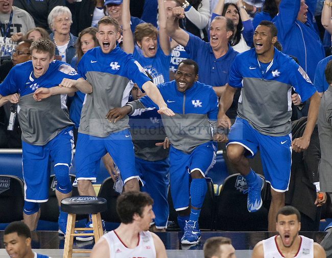 The UK bench cheers on the Wildcats after scoring during the NCAA Final Four vs. Wisconsin at the AT&T in Arlington, Tx., on Saturday, April 5, 2014. Photo by Eleanor Hasken | Staff