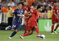 WASHINGTON, DC - July 28, 2012:  Dwayne DeRosario (7) of DC United moves away from Marco Verratti (24) of PSG (Paris Saint-Germain) in an international friendly match at RFK Stadium in Washington DC on July 28. The game ended in a 1-1 tie.
