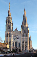 Western facade of Chartres cathedral, a Gothic cathedral built 1194-1250, with a 105m plain pyramid spire built c. 1160, a 113m early 16th century spire on top of an older tower, and the Western rose window, made c. 1215 and 12m in diameter, Eure-et-Loir, France. Chartres cathedral was declared a UNESCO World Heritage Site in 1979. Picture by Manuel Cohen