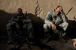 Specialists Allen, left, and Adam Holmgren of the 82nd Airborne, 1/508, Alpha Company, Third platoon take a break as they advance towards the city center of Sangin, Helmand province, Afghanistan on Friday, April 6. 2007.