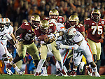 FSU quarterback Jameis Winston fumbles the ball for a turnover in the second quarter of the BCS national title game at the Rose Bowl in Pasadena, California on January 6, 2014.   The Florida State Seminoles defeated the Auburn Tiger 34-31 to win the final BCS National Championship.