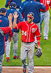 20 April 2013: Washington Nationals outfielder Bryce Harper gets high-fives from the coaching staff as he returns to the dugout at the end of play against the New York Mets at Citi Field in Flushing, NY. Harper went 3 for 3 with 3 RBIs and two home runs as the Nationals defeated the Mets 7-6 to tie their 3-game series at one a piece. Mandatory Credit: Ed Wolfstein Photo *** RAW (NEF) Image File Available ***