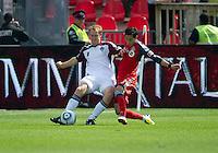 17 September 2011: Colorado Rapids midfielder Jeff Larentowicz #4 and Toronto FC midfielder Eric Avila #8 in action during a game between the Colorado Rapids and Toronto FC at BMO Field in Toronto.