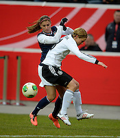Offenbach, Germany, Friday, April 05 2013: Womans, Germany vs. USA, in the Stadium in Offenbach,   Alex Morgan (USA),  Linda Bresonik (GER)..