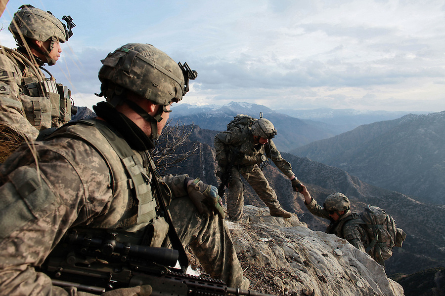 The soldiers of 1st Platoon Bravo Co. 1-26 Infantry 1st Infantry Division patrol the mountain slopes of Afghanistan's Korengal Valley in Kunar Province from their home, Firebase Restrepo, high above the valley floor.