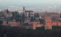 The Alhambra Palace, Granada, Andalusia, Southern Spain, with the Comares Tower, built in the 14th century under Muhammad V, the tallest tower in the Alhambra and housing the Hall of the Ambassadors, Nasrid Palaces and the Palace of Charles V in the background, built by Pedro Machuca in the 16th century. The Alhambra was begun in the 11th century as a castle, and in the 13th and 14th centuries served as the royal palace of the Nasrid sultans. The huge complex contains the Alcazaba, Nasrid palaces, gardens and Generalife. Picture by Manuel Cohen