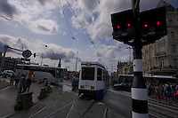 A different kind of Red light district in Amsterdam: a mixed traffic jam between modes of transit.