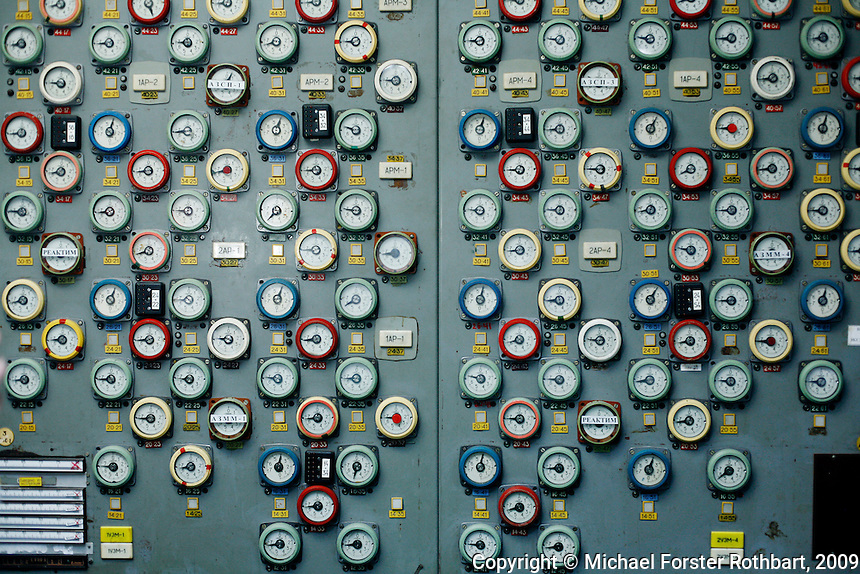 A wall of dials in the Chernobyl First Block control room once marked the depth of each control rod in the reactor core. Just down the hall is the burnt-out Fourth Block control room, where a combination of design flaws and human error triggered the accident during a late-night safety test. Most estimates say ninety-five percent of the radioactive materials remained on the grounds of the power plant or spread to the adjacent forest. Both were decontaminated, using the labor of about 850,000 liquidators from across the Soviet Union..-------------------.This photograph is part of Michael Forster Rothbart's After Chernobyl documentary photography project..© Michael Forster Rothbart 2007-2010..www.afterchernobyl.com.www.mfrphoto.com o 607-267-4893 o 347-722-0479.20 Gardner Place, #59, Oneonta, NY 13820.86 Three Mile Pond Rd, Vassalboro, ME 04989.info@mfrphoto.com.Photo by: Michael Forster Rothbart.Date:  1/2009    File#:  Canon 5D digital camera frame 51336