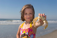 Child holding a Ghost Crab, Stone Harbor, New Jersey