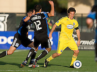 Guillermo Barros Schelotto of the Crew dribbles the ball away from Earthquakes' Jason Hernandez and Ramiro Corrales during the game at Buck Shaw Stadium in Santa Clara, California on June 2nd, 2010.  San Jose Earthquakes tied Columbus Crew, 2-2.