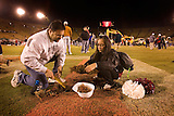 Stanford football vs Notre Dame. Last game at stadium before renovation. Stanford loses 38-31...Stanford cheerleader, Marcela Estrada (sr) and her father, Albert Estrada dig up part of the endzone. This was Marcela's last game. 37 of her relatives were at the game.