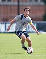 Joey Dillon (4) of Georgetown carries the ball forward at Shaw Field in Washington, DC.  Georgetown defeated Seton Hall, 8-0.