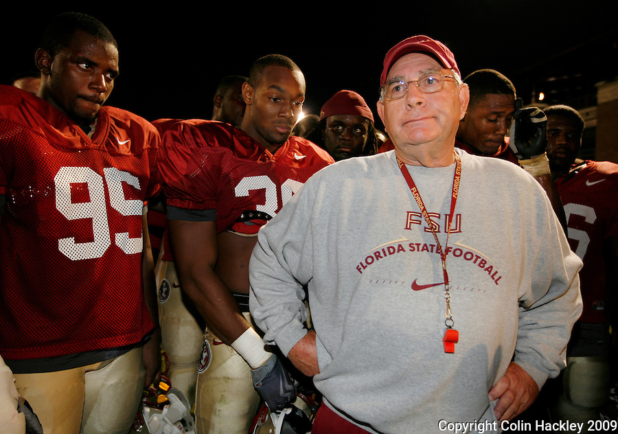 TALLAHASSEE, FL 11/3/09-FSU-ANDREWS RETIRE CH09-Florida State Defensive Coordinator Mickey Andrews is surrounded by his players as he announces that he will retire Feb. 10, 2010, Tuesday during a news conference in Tallahassee. ..COLIN HACKLEY PHOTO