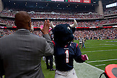 Houston, Texas<br /> October 2, 2011<br /> <br /> General manager and first as executive vice president, Rick Smith (grey jacket) greets the team mascot on the sidelines as the game is about to begin. <br /> <br /> The Houston Texans defeated the Pittsburgh Steelers at the Reliant Stadium 17 to 10.
