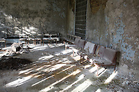 Hospital waiting room with discarded pot plant<br />