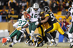 PITTSBURGH, PA - JANUARY 23: Brad Smith #16 of the New York Jets is tackled by Keyaron Fox #57 of the Pittsburgh Steelers in the AFC Championship Playoff Game at Heinz Field on January 23, 2011 in Pittsburgh, Pennsylvania(Photo by: Rob Tringali) *** Local Caption *** Brad Smith;Keyaron Fox
