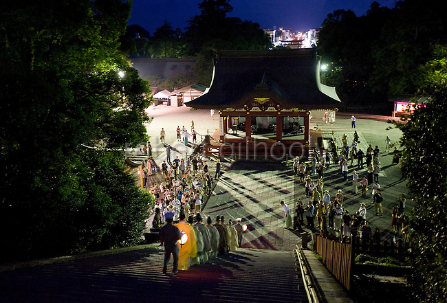 Priests are led down the 61 steps from the inner sanctuary during the annual Reitaisai Grand Festival at Tsurugaoka Hachimangu Shrine in Kamakura, Japan on  14 Sept. 2012.  Sept 14 marks the first day of the 3-day Reitaisai festival, which starts early in the morning when shrine priests and officials perform a purification ritual in the ocean during a rite known as hamaorisai and limaxes with a display of yabusame horseback archery. Photographer: Robert Gilhooly